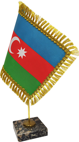 Flag of Azerbaijan with a fringe on a stand with a granite base.
