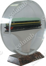 Souvenir plastic case for the locomotive model on a granite basement.
